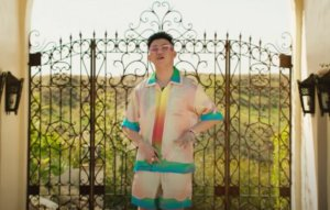 Watch Rich Brian rap 'Sydney' from a lavish mansion in new music video